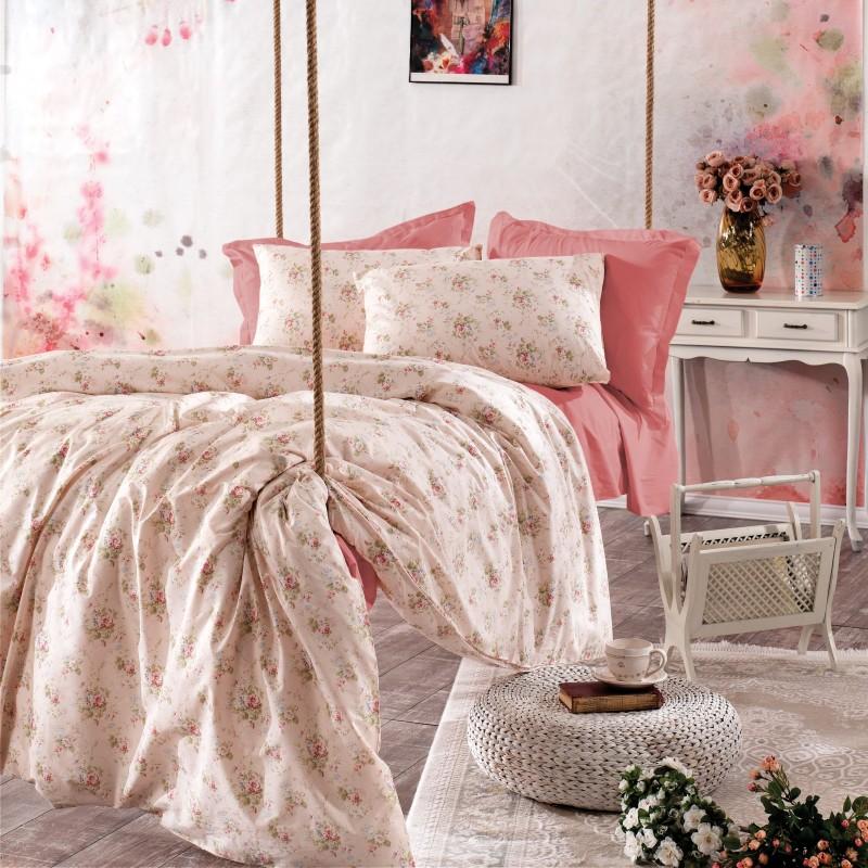 Parure de lit rose avec motifs
